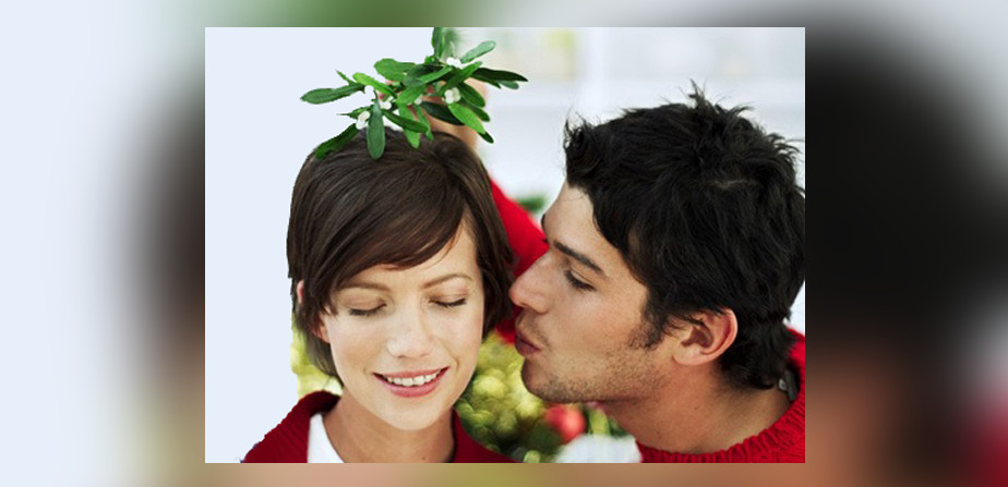 Kiss under mistletoe